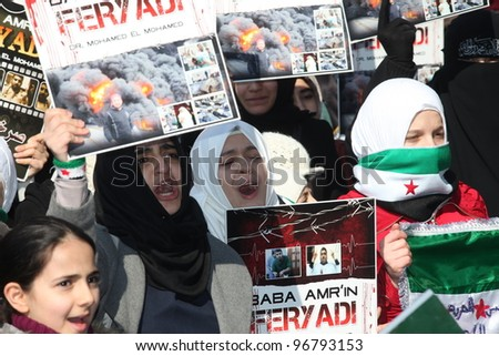 ISTANBUL, TURKEY-MARCH 2: A group of unidentified people stage a demonstration in front of the Beyazit Mosque, protesting Syrian authorities' violent crackdown in Homs, on March 2, 2012 in Istanbul,Turkey - stock photo