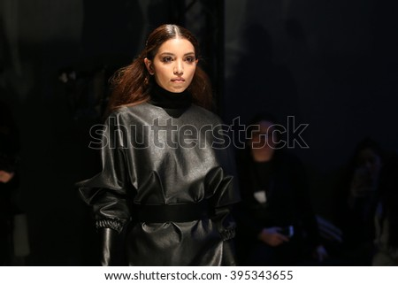 ISTANBUL, TURKEY - MARCH 18, 2016: A model showcases one of the latest creations of Derya Acikgoz in Mercedes-Benz Fashion Week Istanbul