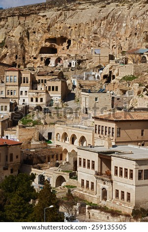 ISTANBUL, TURKEY - MARCH 04, 2015:Cappadocia, Central Anatolia in Turkey. Desert landscape with ancient rock carved houses in Goreme turkish Kapadokya region in Asia Minor. - stock photo