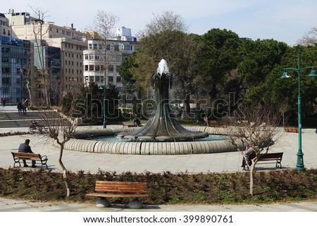 ISTANBUL, TURKEY - MARCH 21, 2016:Fountain in Taksim Gezi Park.Fountain in Taksim Gezi Park is an urban park next to Taksim Square in Istanbul Beyoglu district  - stock photo