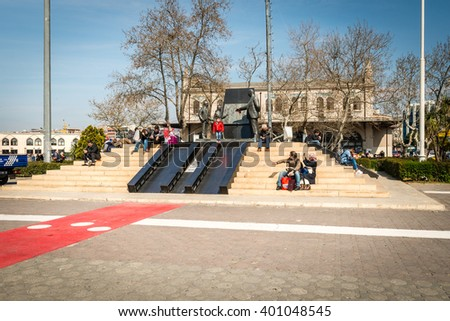 Istanbul, Turkey - March 29, 2016: People are spending leasure time near statue os Ataturk in Kadikoy, Istanbul