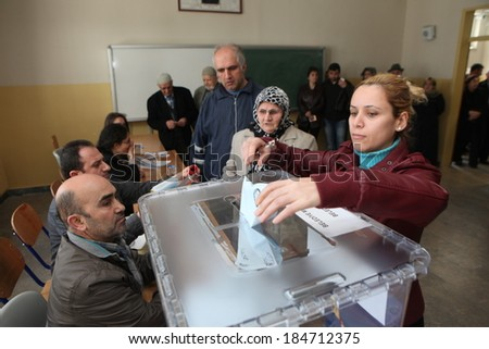 ISTANBUL, TURKEY-MARCH 30: Turks flee to election centers to vote for the Turkish local Elections on March 30, 2014 in Istanbul, Turkey. - stock photo