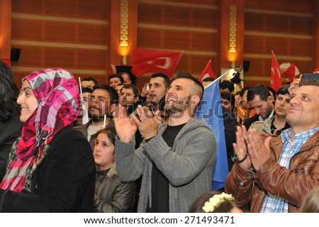 ISTANBUL, TURKEY - MARCH  30 :  Winning local elections the AK Party supporters to celebrate on March 30, 2014. AKP leader Recep Tayyip Erdogan's speech on television the following supporters