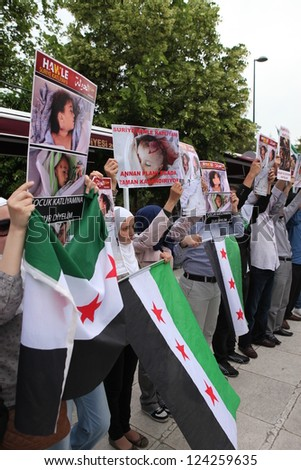 ISTANBUL, TURKEY-MAY 29: A group of unidentified people stage a demonstration in front of the Fatih Mosque, protesting Syrian authorities' violent crackdown in Homs, on May 29, 2012 in Istanbul,Turkey - stock photo