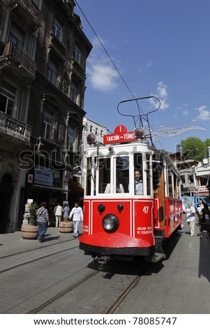 ISTANBUL, TURKEY - MAY 25 : An unidentified  man rides a tram on Istiklal Street,on May 25, 2011 in Istanbul, Turkey.Istiklal Street is a busy pedestrian shopping street leading to Taksim Square in Istanbul. - stock photo