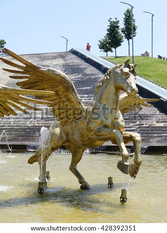 ISTANBUL, TURKEY - MAY 29, 2016: Bakirkoy District in istanbul.Beautiful Botanic Park in Bakirkoy District,There is Pegasus horse sculptures  - stock photo