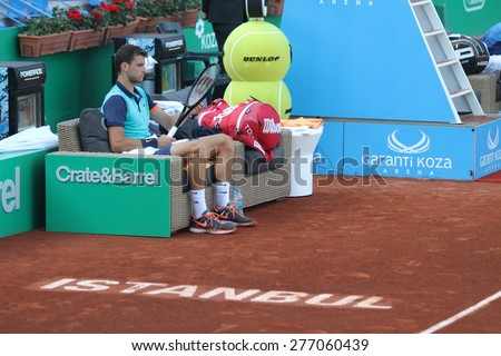 ISTANBUL, TURKEY - MAY 01, 2015: Bulgarian player Grigor Dimitrov in action during quarter final match against Croatian player Ivan Dodig in TEB BNP Paribas Istanbul Open 2015