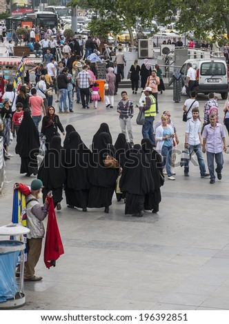ISTANBUL, TURKEY - MAY 30, 2014:Crowd in Eminou District. Eminonu Square, . Eminonu Square is so crowded on day.People watching golden horn.