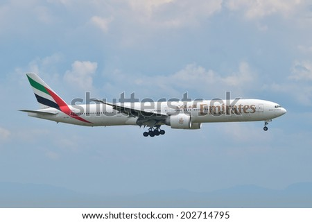 ISTANBUL, TURKEY - MAY 2, 2014: Emirates Boeing 777 landing at Istanbul Ataturk Airport.  This aircraft, A6-EBT, was delivered to Emirates in 2006. - stock photo