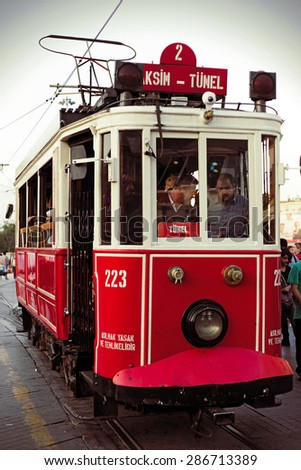 ISTANBUL, TURKEY - MAY 21, 2015 : Famous historic Red Tram on Istiklal street in Istanbul.