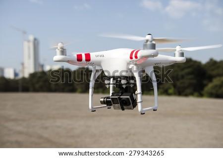 ISTANBUL, TURKEY - MAY 19 ,2015: Flying drone quadcopter Dji Phantom 2 with digital camera GoPro HERO4. - stock photo