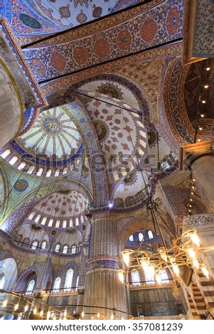 ISTANBUL, TURKEY - MAY 25, 2014: Interior of the Sultan Ahmed Mosque (Blue Mosque). The mosque was built in 1609-1616 by design of architect Sedefkar Mehmed Agha during the rule of sultan Ahmed I. - stock photo