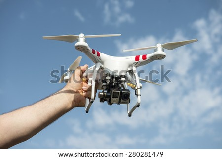 ISTANBUL, TURKEY - MAY 19, 2015: Man holding drone.Drone quadrocopter Dji Phantom 2 with digital camera GoPro HERO4 Black edition. New tool for aerial photo and video. - stock photo