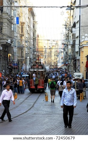 ISTANBUL, TURKEY - MAY 14 : Taksim Istiklal Street at eventide on May 14, 2010 in Istanbul, Turkey. Taksim Istiklal Street is a popular destination in Istanbul. - stock photo