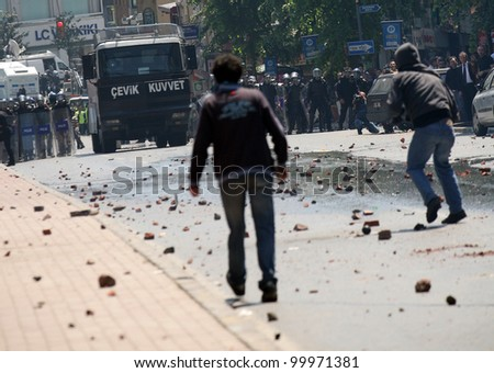 ISTANBUL, TURKEY - MAY 1: The demonstrators who are against to prohibition of 1 May celebration were arrested by the police on May 1,2008 in Istanbul,Turkey - stock photo