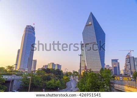 Istanbul, Turkey  - May 24, 2016: The futuristic skyscraper, headquarters building of Finansbank in 4th Levent Distric of Istanbul.