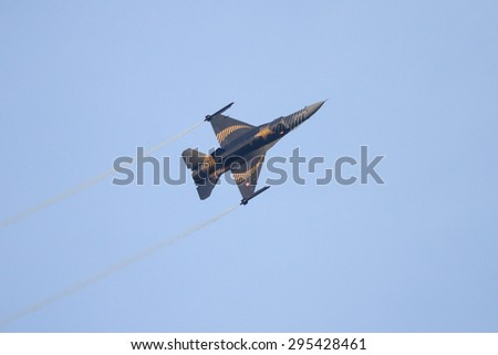 ISTANBUL, TURKEY - MAY 17, 2015: Turkish Air Force Solo Aerobatics Display Team Solo Turk performs. Solo Turk airplane is a F-16 C Blok-40 fighter jet.