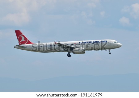 ISTANBUL, TURKEY - MAY 2, 2014: Turkish Airlines Airbus A321 landing at Istanbul Ataturk Airport.  This aircraft, TC-JRO, flying for the Turkish flag carrier since 2011. - stock photo