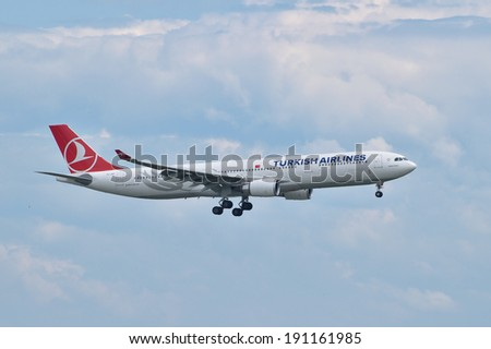ISTANBUL, TURKEY - MAY 2, 2014: Turkish Airlines Airbus A330 landing at Istanbul Ataturk Airport.  This widebody aircraft, TC-JNT, was built and delivered to the Turkish flag carrier in 2013.
