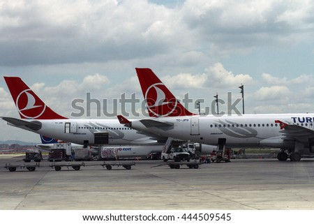 ISTANBUL, TURKEY - May 29, 2015: Turkisk Airlines , Airbus A320 waiting for boarding at Turkey's largest airport, Istanbul Ataturk, Turkey. - stock photo