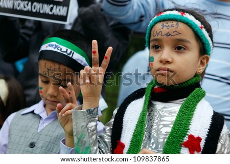 ISTANBUL,TURKEY-MAY 29: Unidentified children participate a demonstration protesting Syrian authorities' violence , on May 29, 2012 in Istanbul, Turkey - stock photo