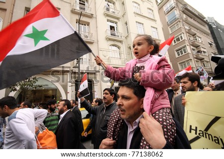 ISTANBUL,TURKEY-MAY 13: Unidentified Syrians living in Istanbul and Civil Society Organizations protest the regime of Bashar Essad in front of Syrian Consulate building on May 13, 2011 in Istanbul, Turkey. - stock photo