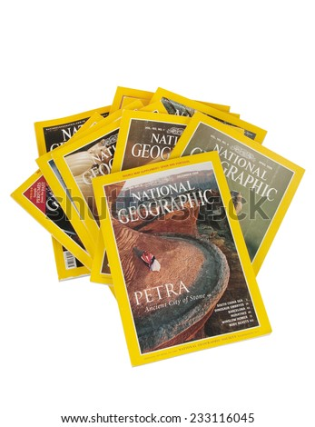 ISTANBUL, TURKEY  25, 2014:  National Geographic Magazines  isolated on white background. National Geographic Magazine has been published continuously since its first issue in October 1888.