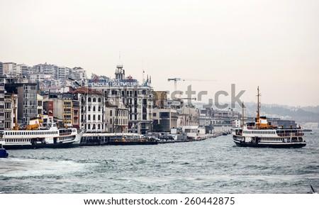 ISTANBUL, TURKEY - NOVEMBER 28: Floating ship and city buildings in Istanbul, Turkey on November 28, 2014 - stock photo