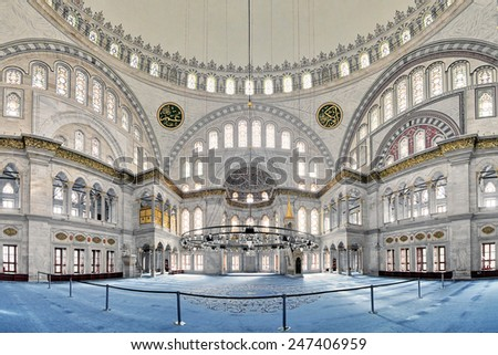 ISTANBUL, TURKEY - NOVEMBER 13, 2014: Interior of Nuruosmaniye Mosque. The mosque was commissioned from the order of Sultan Mahmut I beginning in 1748 and completed by Sultan Osman III in 1755. - stock photo
