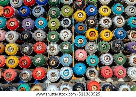 Istanbul, Turkey-November 3, 2016: Painted and stacked spray paint canisters