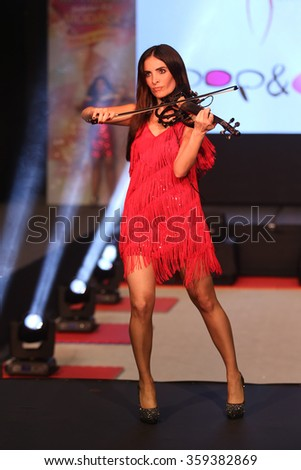 ISTANBUL, TURKEY - NOVEMBER 07, 2015: Violinist Giselle Tavilson performs during Optimum Fashion days catwalk
