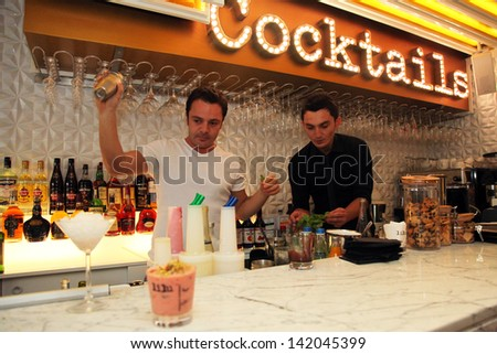 ISTANBUL, TURKEY - OCTOBER 18: Bartender is pouring a drink at the famous cocktail bar Lilu on October 18, 2012 in Istanbul, Turkey. - stock photo