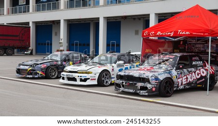 ISTANBUL, TURKEY - OCTOBER 11, 2014: Drift cars in garage area of Istanbul Park circuit during FIA World Rallycross Championship. - stock photo