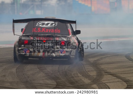 ISTANBUL, TURKEY - OCTOBER 11, 2014: Driver George Christoforou performs drift during FIA World Rallycross Championship. - stock photo
