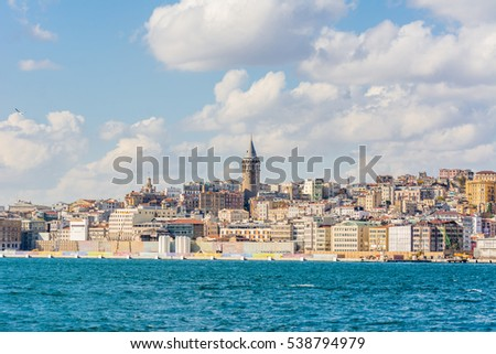 Istanbul, Turkey, October 31, 2016 Editorial: Cityscape of Bosphorus strait with ancient Galata tower and modern buildings in Istanbul Turkey from ferry on a sunny day with background cloudy sky