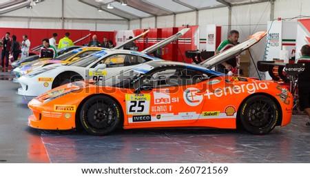ISTANBUL, TURKEY - OCTOBER 25, 2014: Motor Piacenza Racing Team cars in paddock area of Ferrari Racing Days in Istanbul Park Racing Circuit - stock photo
