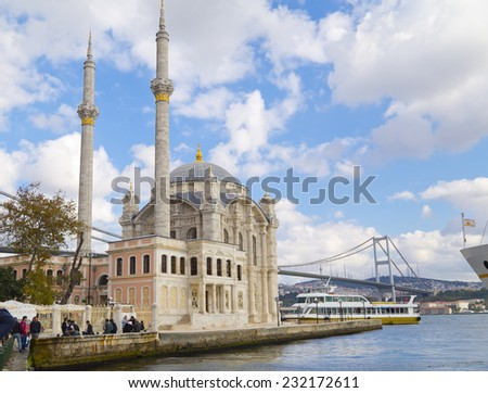 Istanbul, Turkey - October 19, 2014: Ortakoy Mosque and the Bosporus Bridge on October 19, 2014. The two iconic landmarks of Istanbul can be seen from Ortakoy square by the Bosporus. - stock photo