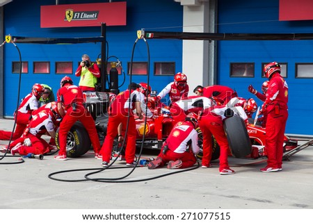 ISTANBUL, TURKEY - OCTOBER 26, 2014: Pit stop of Formula 1 car in Ferrari Racing Days in Istanbul Park Racing Circuit - stock photo