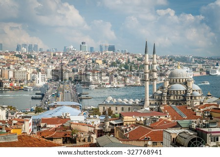 Istanbul, Turkey - October 5, 2015: View from the rooftops of Grand bazaar in Istanbul. Galata bridge and Valide Sultan Mosque - stock photo