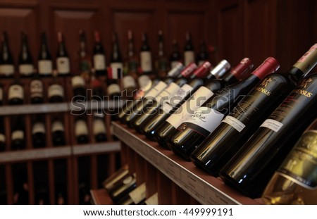 ISTANBUL, TURKEY - OCTOBER 25: Wine room with bottles on wooden shelves in Turkish restaurant on October 25, 2013 in Istanbul, Turkey. - stock photo