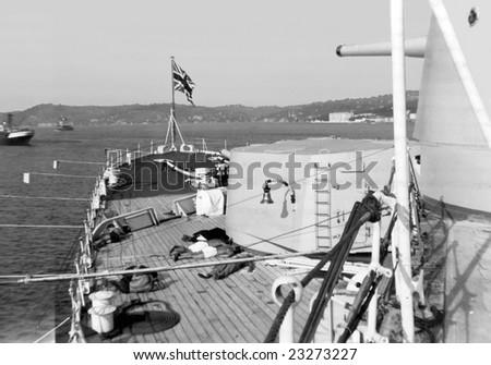 ISTANBUL, TURKEY - 1950s - Royal Navy sailors sunbathing on deck in port in Istanbul - stock photo