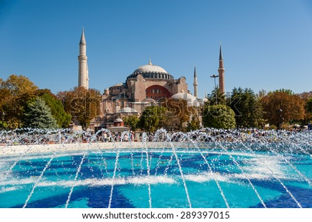 ISTANBUL, TURKEY - SEPTEMBER 23, 2012: Byzantine architecture of the Hagia Sophia (The Church of the Holy Wisdom) and a park with fountain tranquil scenery in Istanbul, Turkey. - stock photo