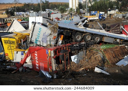 ISTANBUL, TURKEY - SEPTEMBER  09: Crashed cars in the  after flood disaster on September 09, 2009 in Istanbul, Turkey. The floods destroyed roads and houses and swept away about 200 cars.