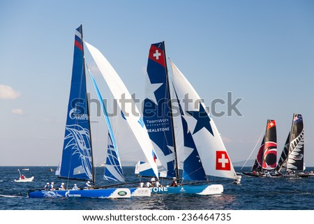 ISTANBUL, TURKEY - SEPTEMBER 13, 2014: Gazprom Team Russia and Realteam compete in Extreme Sailing Series.