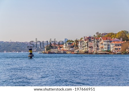 ISTANBUL, TURKEY - SEPTEMBER 29, 2013: Panoramic view of the old waterfront houses in Yenikoy.