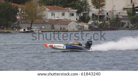 ISTANBUL, TURKEY - SEPTEMBER 26: Philippe BENHAMOU and Jerome BRARDA drive MarseilleTeam Offshore225 boat during Architon Offshore Championship, Halic stage on September 26, 2010 in Istanbul, Turkey
