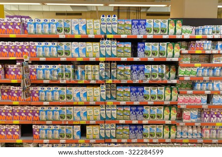 Istanbul, Turkey - 30 September 2015:  Selection of yogurts, soy milk and milk on the shelves in a supermarket Istanbul, Turkey. - stock photo