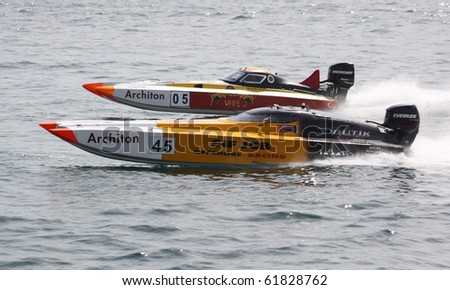 ISTANBUL, TURKEY - SEPTEMBER 19: Suha YENIGUL and Ilker OZMEN drive a SIF - JCB Team Offshore 225 boat during Architon Offshore Championship, Moda stage on September 19, 2010 in Istanbul, Turkey