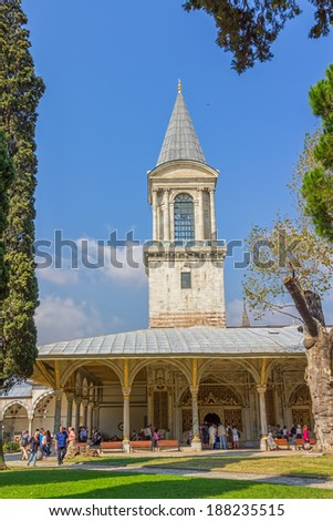 ISTANBUL, TURKEY - SEPTEMBER 27, 2013: Tourists sightseeing The Tower of Justice in Topkapi Palace in Istanbul. Official and primary residence in the city of the Ottoman Sultans for 400 years. - stock photo