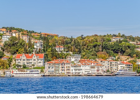 ISTANBUL, TURKEY - SEPTEMBER 29, 2013: View of the Arnavutkoy old wooden residental buildings sailing Bosporus.